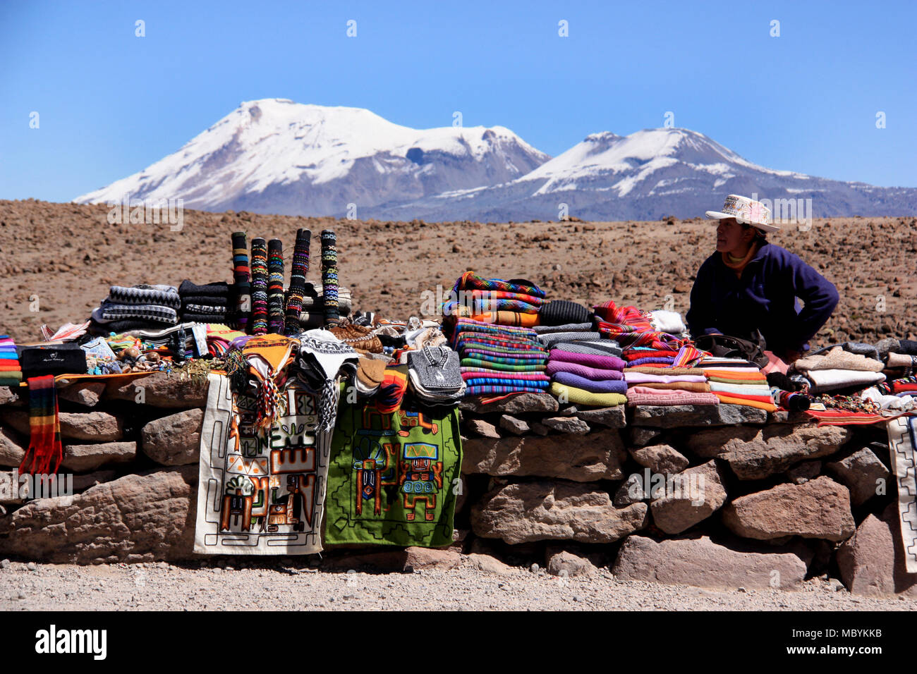 Peruvian Woman selling traditional Textiles on Top of a high Mountain Pass in the Andes - Stock Image