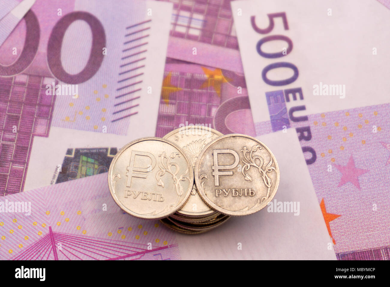 ruble coins and the symbol of the ruble and the numbers on Euro notes - Stock Image