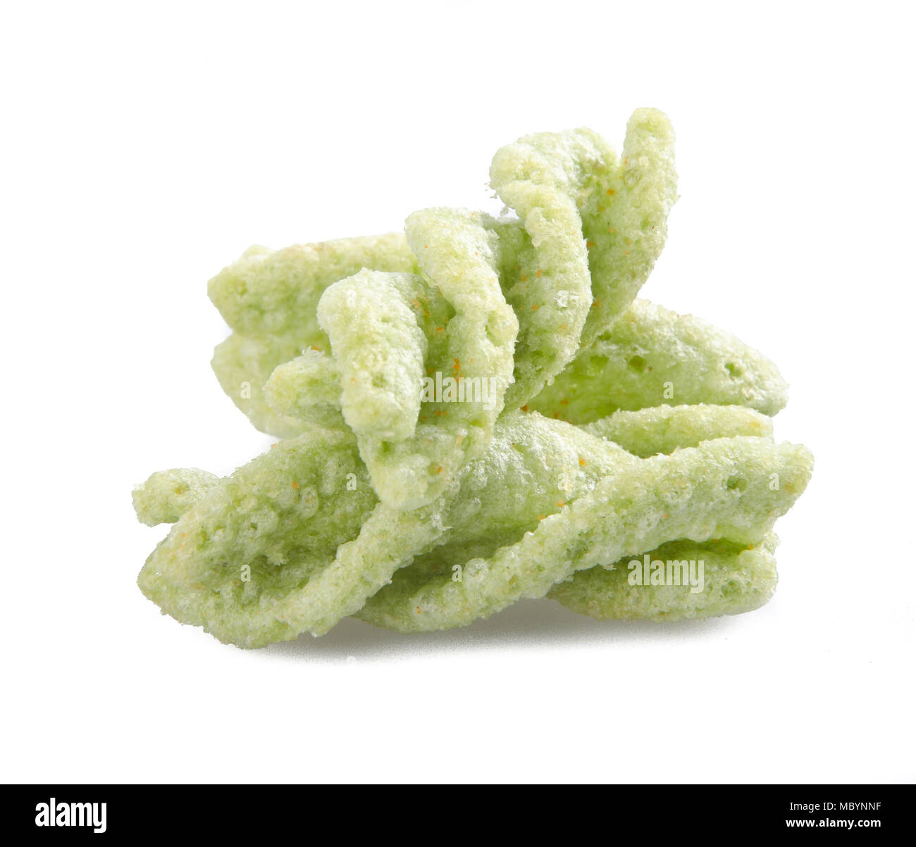 Junk food, green peas snack on a background - Stock Image