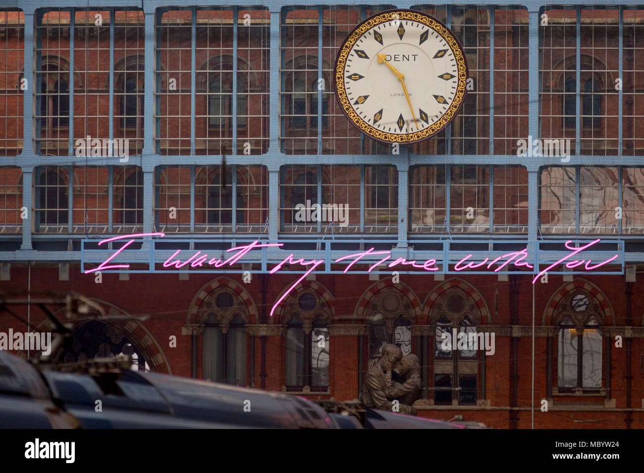 The new artwork entitled 'I Want My Time With You' by British (Britpop) artist Tracy Emin hangs over the main concourse at St. Pancras Station, on 10th April 2018, in London, England. In the sixth year of the Terrace Wires Commission - and in celebration of the 150th anniversary of St Pancras International and the 250th anniversary of the Royal Academy of Arts, at one of London's mainline station, the London hub for Eurostar - the 20 metre-long greeting to commuters reads 'I Want My Time With You' and Emin thinks that arriving by train and being met by a lover as they put their arms around the - Stock Image