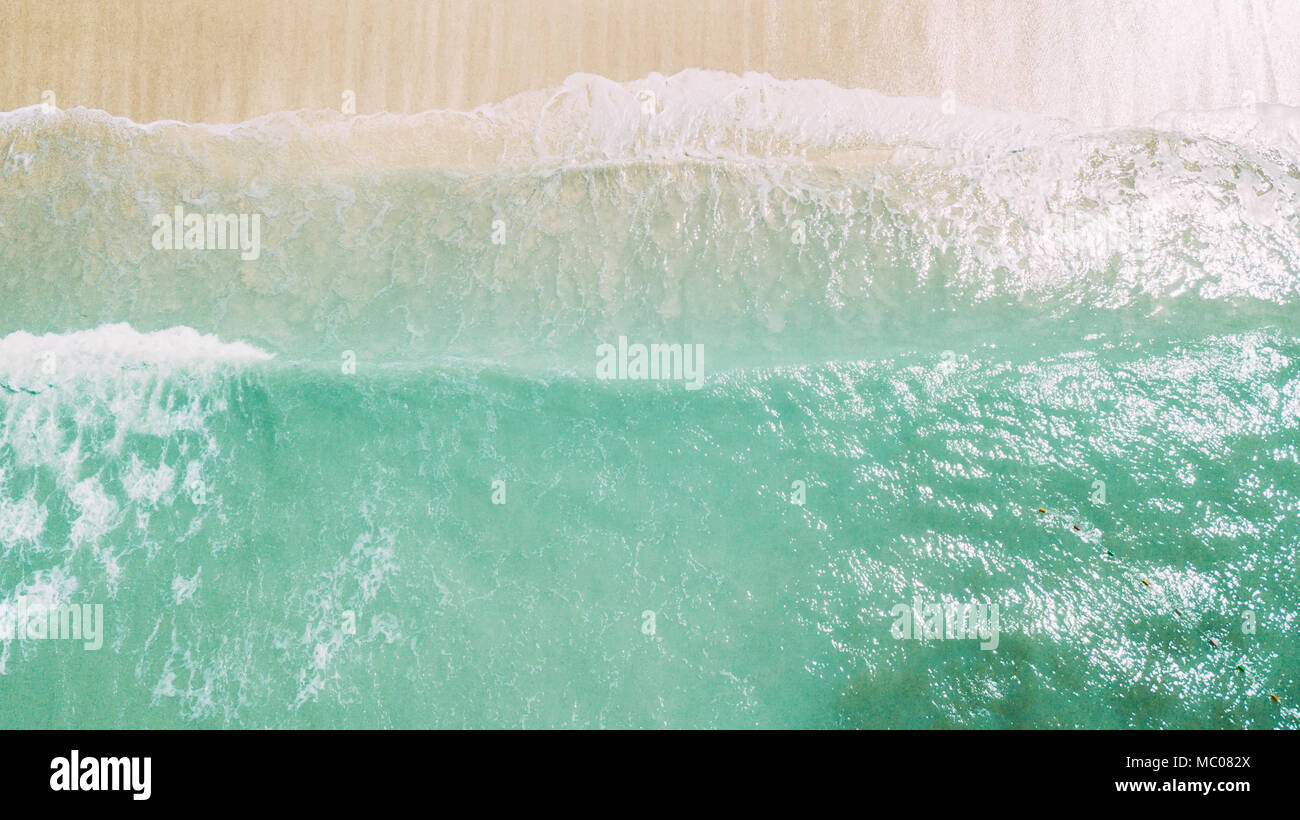white sand and blue ocean. waves on the coast - Stock Image