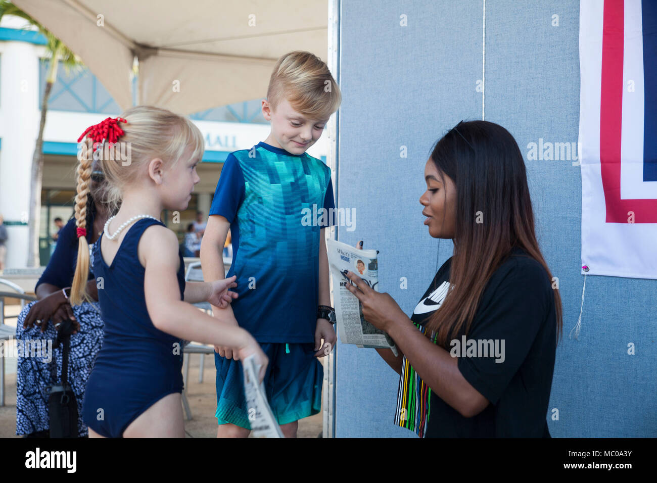 Gold medalist gabby douglas stock photos gold medalist gabby gabrielle gabby douglas signs autographs during a united services organization uso meet m4hsunfo
