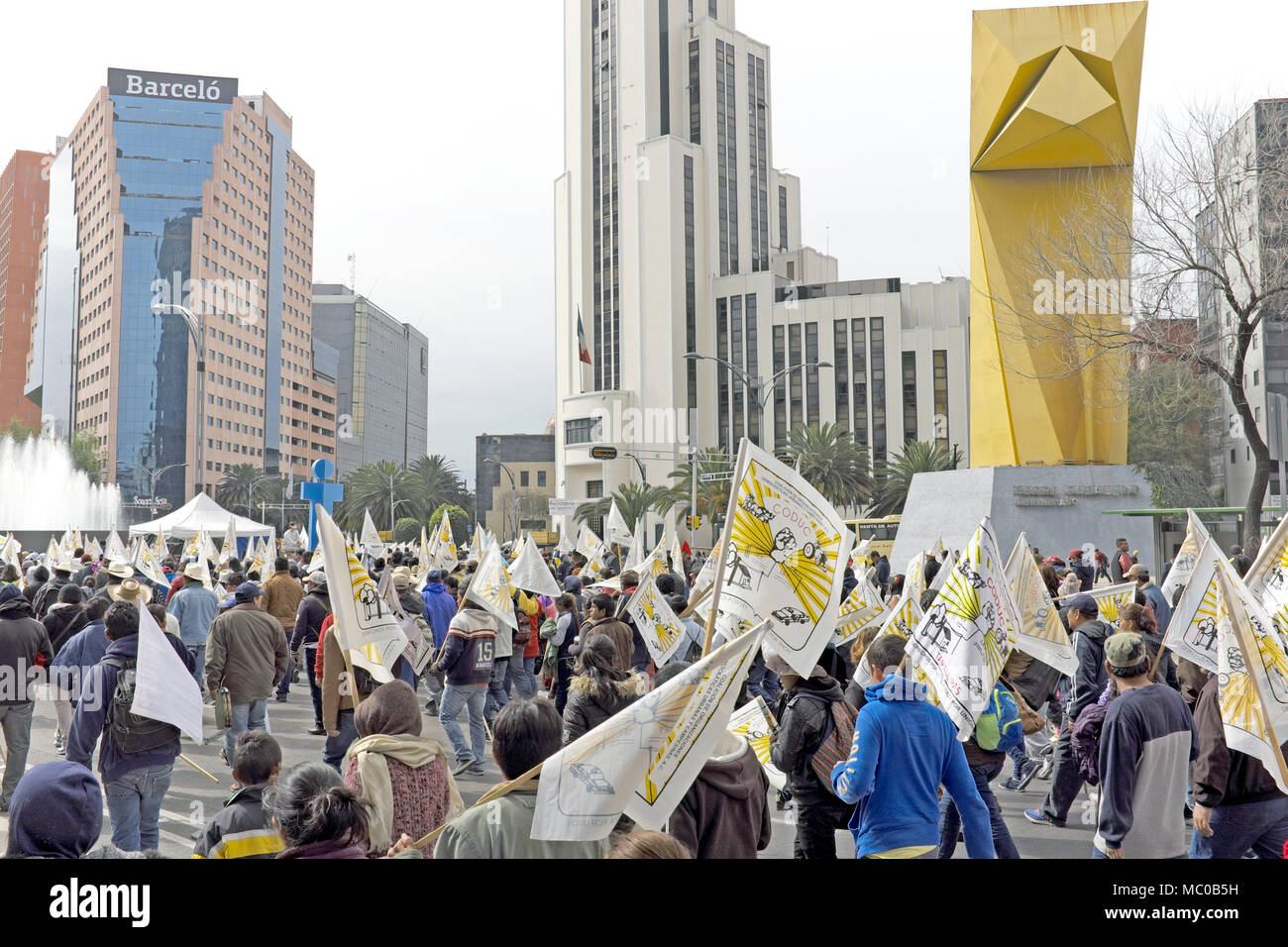 CODUC protesters march past El Caballito towards the Monumento a la Revolucion in Mexico City, Mexico protesting against agricultural policies. - Stock Image