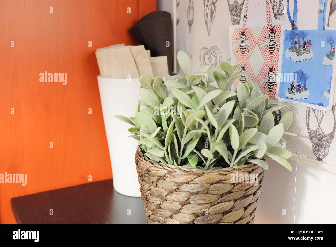 Sewing and Crafting Room with Fabric Rolls, Craft Board and Artificial Green Plant. - Stock Image