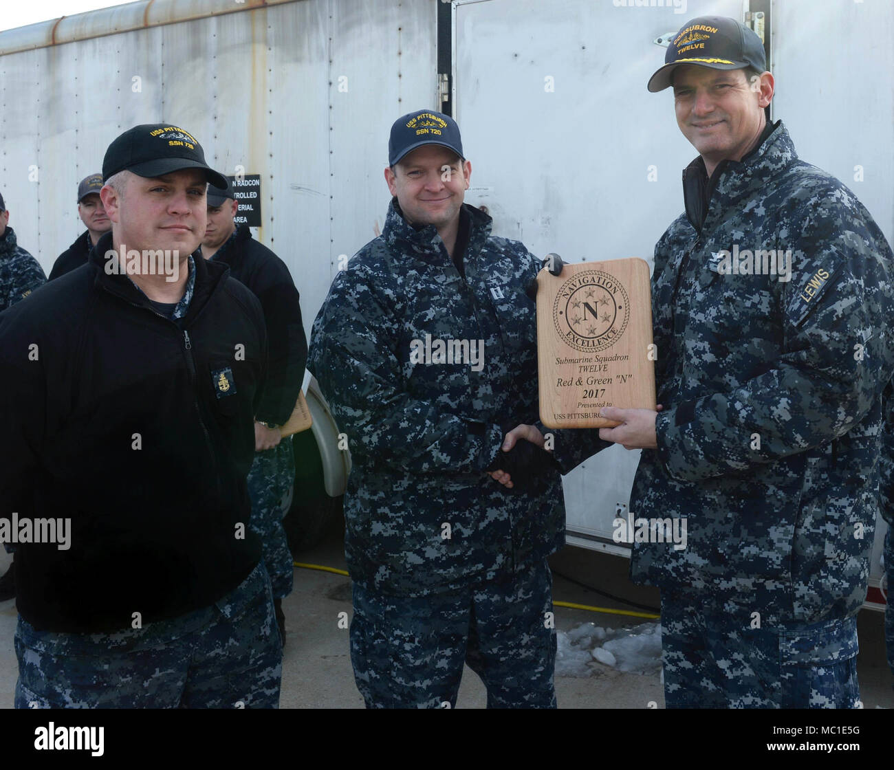 """180119-N-LW591-014 GROTON, Conn. (Jan.19, 2018) Commodore of Submarine Squadron Twelve, Capt. Ollie Lewis presented the Red and Green """"N"""" plaque to representatives of the nuclear-powered, Los Angeles class, fast-attack submarine, USS Pittsburgh (SSN 720), Navigation/Operations department, Lt. Craig Potthast and ETVC David Jackson, Friday, Jan. 19, 2018 onboard Submarine Base New London Groton, Conn.  The Red and Green """"N"""" Navigation/Operations award is part of the Battle Efficiency Competition that's conducted to strengthen and evaluate command and overall force warfighting readiness and to re - Stock Image"""