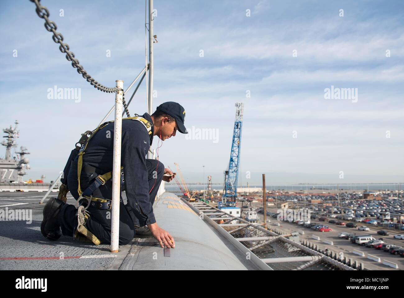 180122-N-NQ487-020 NORFOLK, Va. (Jan. 22, 2018) Airman Edward Mike measures spacing on a future graphic for the bow on the flight deck aboard USS Harry S. Truman (CVN 75). Truman is currently moored at Naval Station Norfolk preparing for the ship's composite training unit exercise (COMPTUEX). (U.S. Navy photo by Mass Communication Specialist 3rd Class Kaysee Lohmann/Released) Stock Photo
