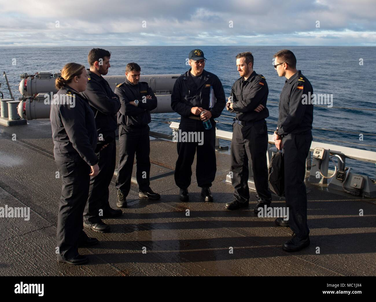 ATLANTIC OCEAN (Jan. 21, 2018) Lt. Robert Harris, middle, the plans and tactics officer aboard the Arleigh Burke-class guided-missile destroyer USS Ross (DDG 71), gives a tour to liaison representatives from the Spanish navy during an exercise between the United States and Spain Jan. 21, 2018. Ross is currently participating in an at-sea exercise with the Spanish navy designed to improve the countries' interoperability when conducting maritime training, including gun and small-boat evolutions. Ross, forward-deployed to Rota, Spain, is on its sixth patrol in the U.S. 6th Fleet area of operation Stock Photo