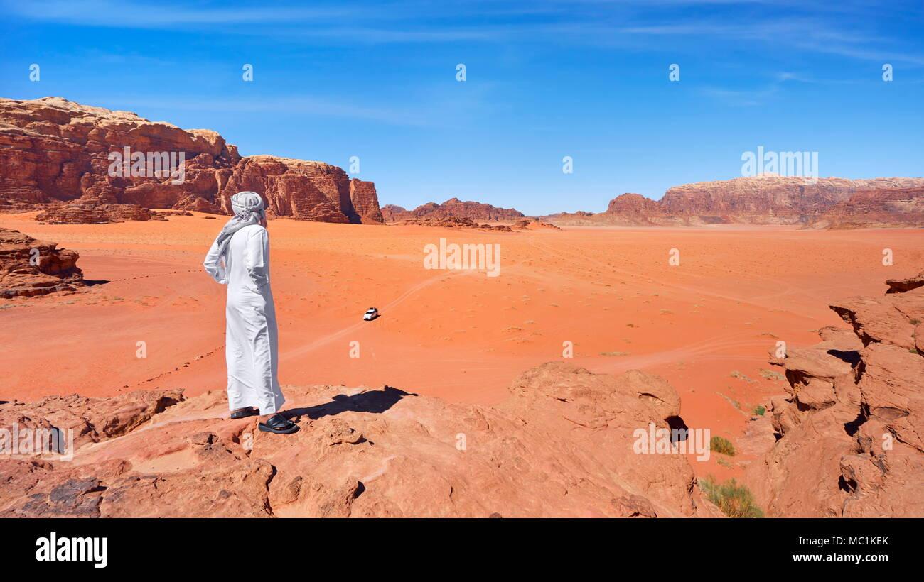 Landscape with local Bedouin man, Wadi Rum Desert, Jordan - Stock Image