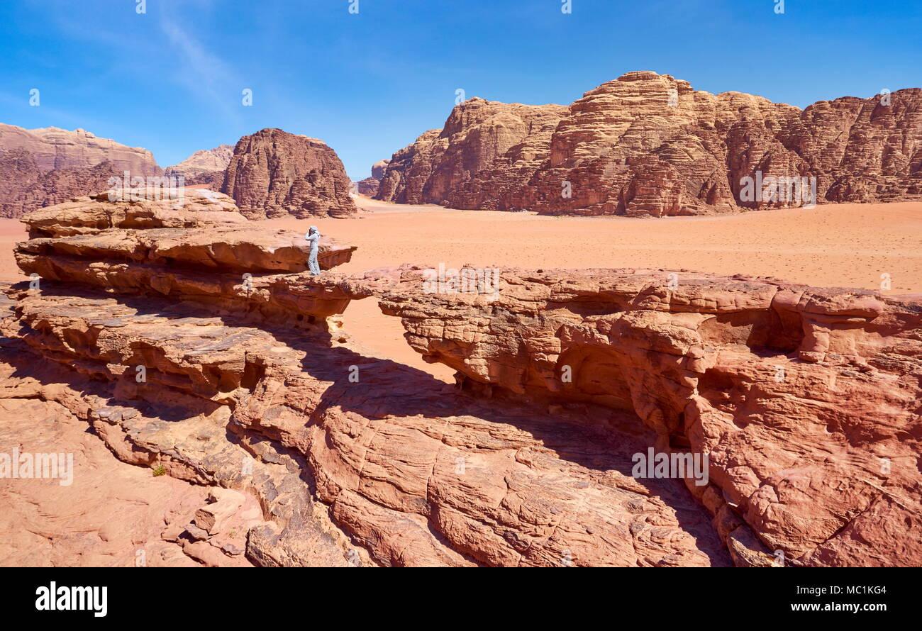 Natural rock bridge in the Wadi Rum Desert, Jordan - Stock Image