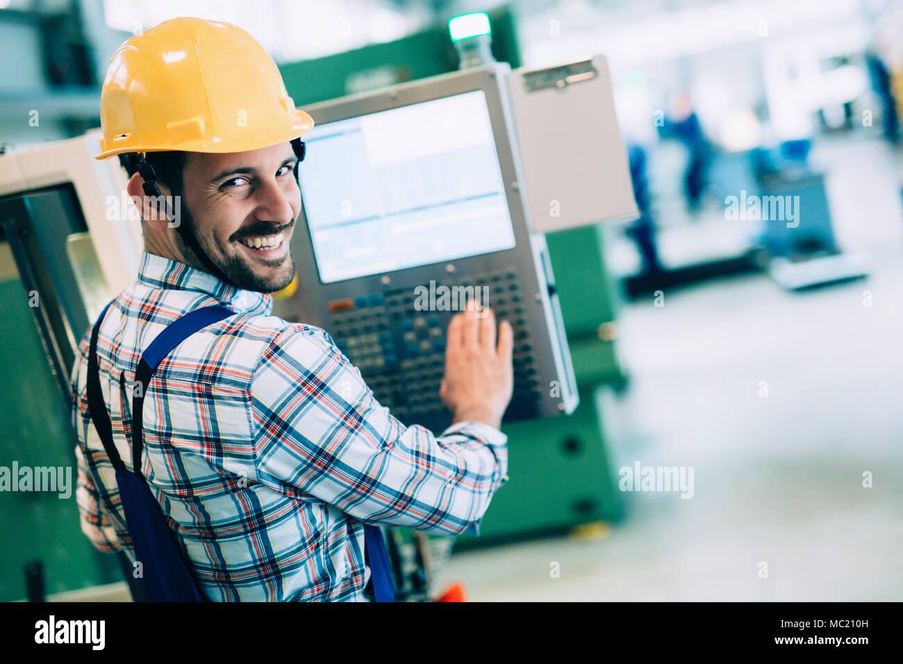 modern industrial machine operator working in factory - Stock Image