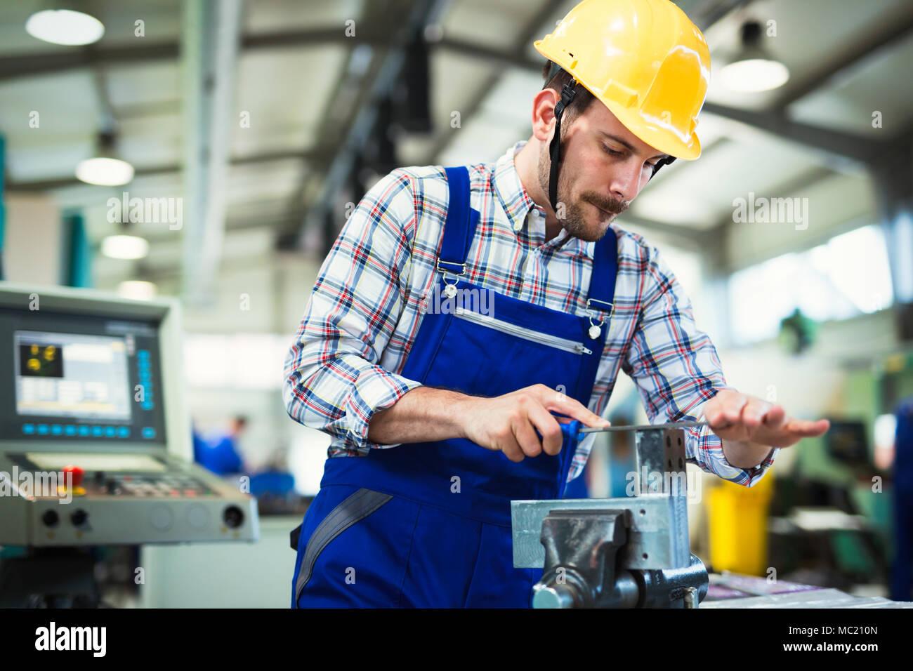Metal industry factory worker working on metal parts Stock Photo