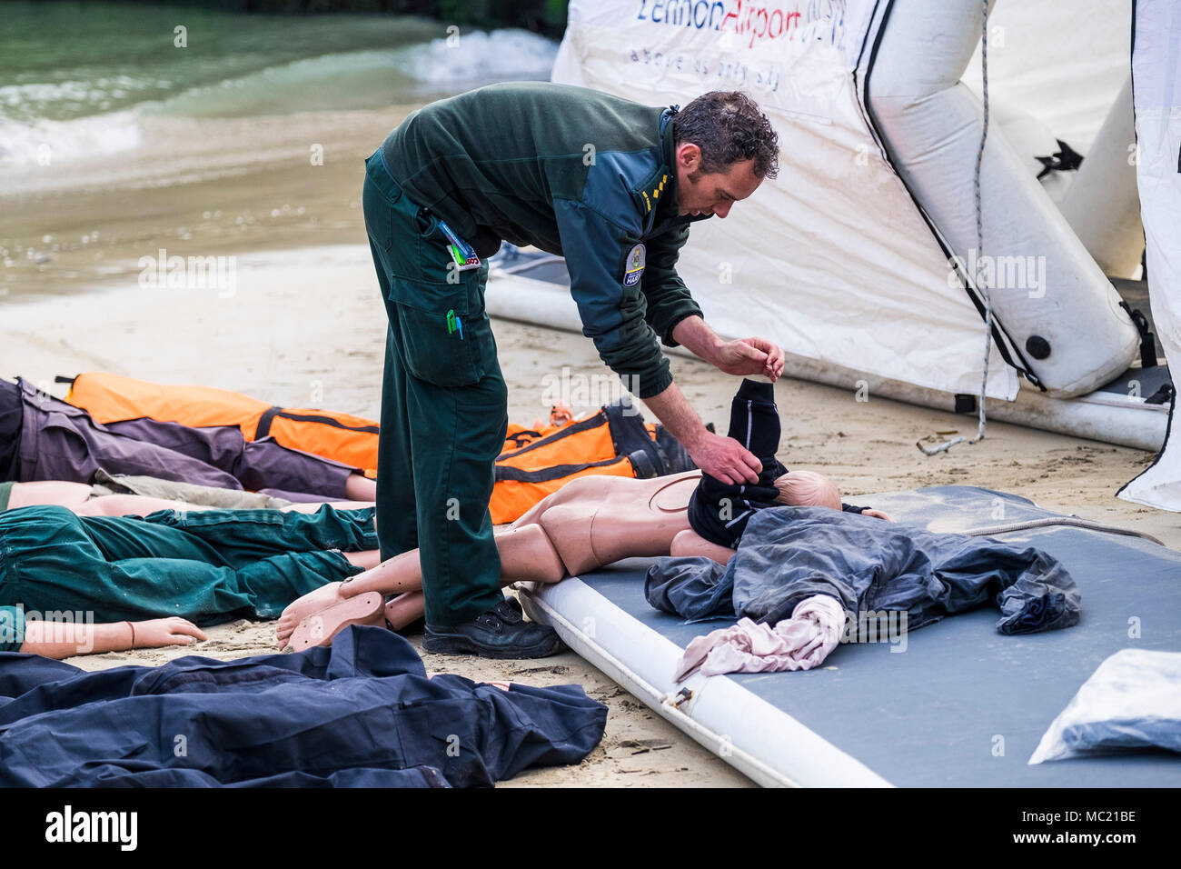 A paramedic preparing mannequins for use in a GMICE (Good Medicine in Challenging Environments) major incident exercise in Newquay Harbour i - Stock Image