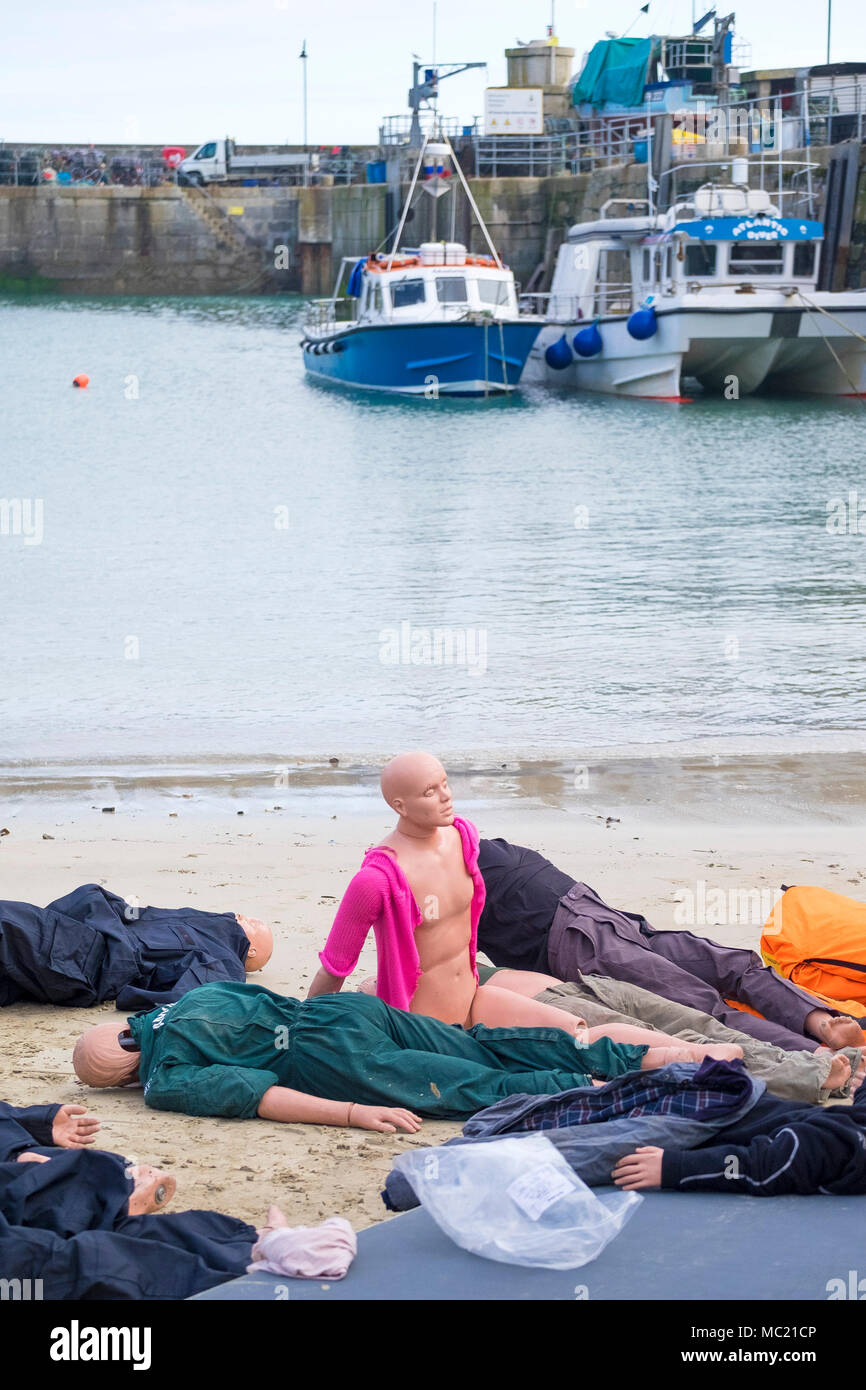 Mannequins waiting to be used in a GMICE (Good Medicine in Challenging Environments) major incident exercise in Newquay Harbour in Cornwall. - Stock Image