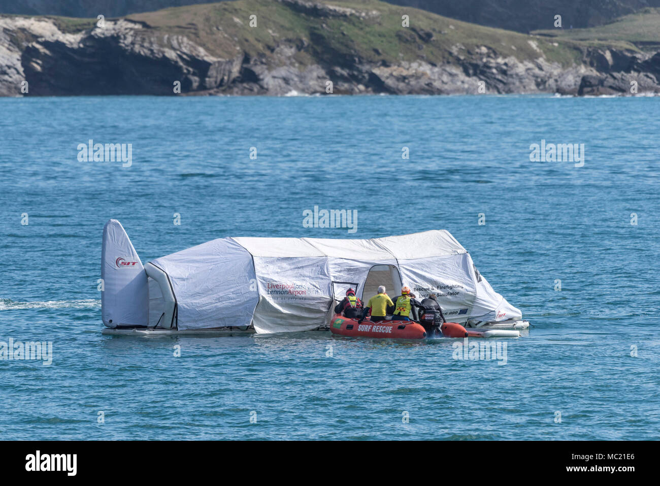 A Rescue and Firefighting Aircraft Simulator floating on the sea and being used in a GMICE (Good Medicine in Challenging Environments) major incident. - Stock Image