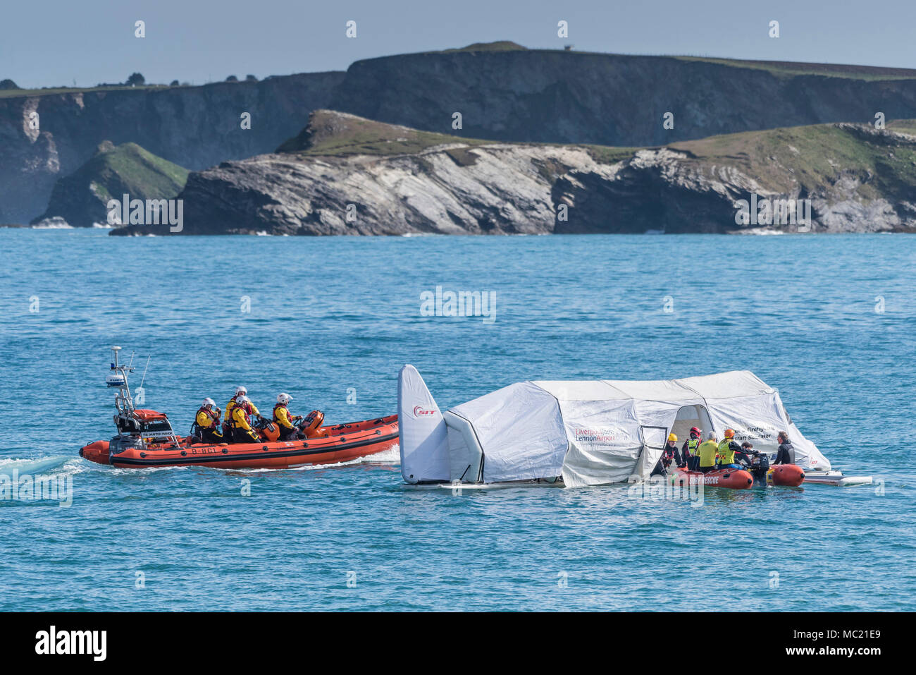 A Rescue and Firefighting Aircraft Simulator floating on the sea and being used in a GMICE (Good Medicine in Challenging Environments) major incident  - Stock Image
