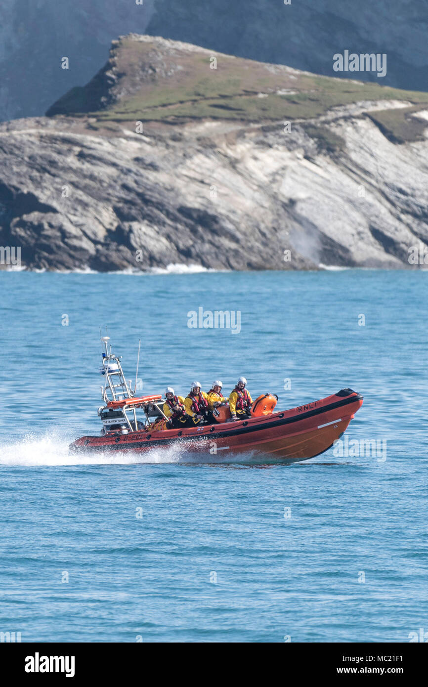 The Newquay volunteer RNLI crew in their B Class Atlantic 85 inshore rescue craft participating in a GMICE (Good Medicine in Challenging Environments) - Stock Image