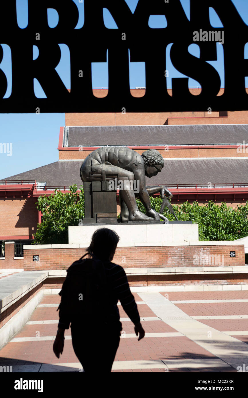The British Library London, with the statue of Isaac Newton by Eduardo Paolozzi in the concourse. - Stock Image