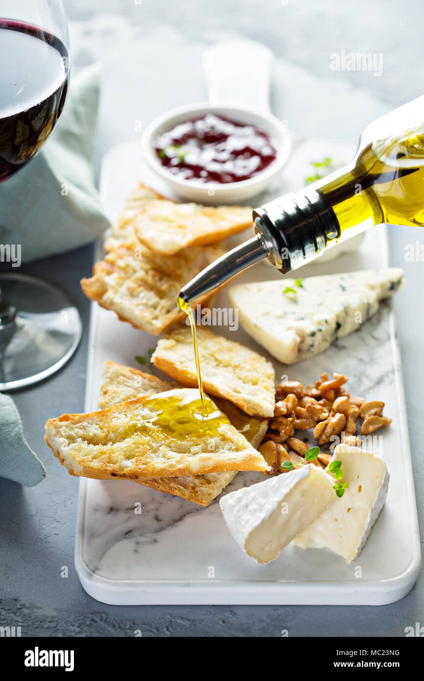 Small cheeseboard with baguette - Stock Image