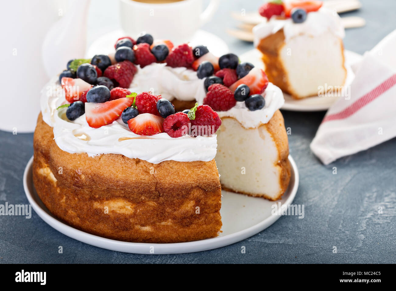 Angel food cake with cream and berries - Stock Image