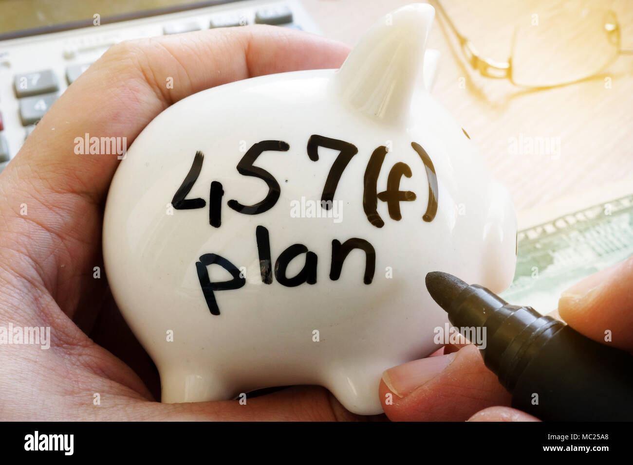 Piggy bank with sign 457f plan. Pension plan. - Stock Image
