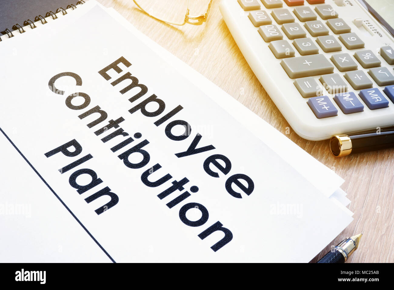 Documents with title Employee Contribution Plan on a desk. - Stock Image
