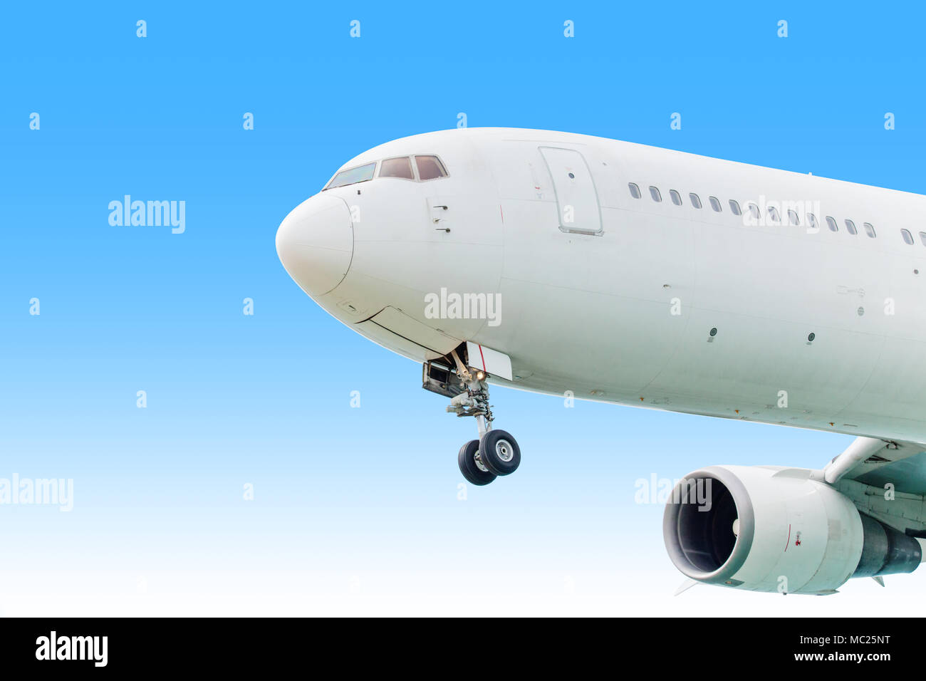 Airplane aircraft flying, landing in the good weather at blue sky - Stock Image