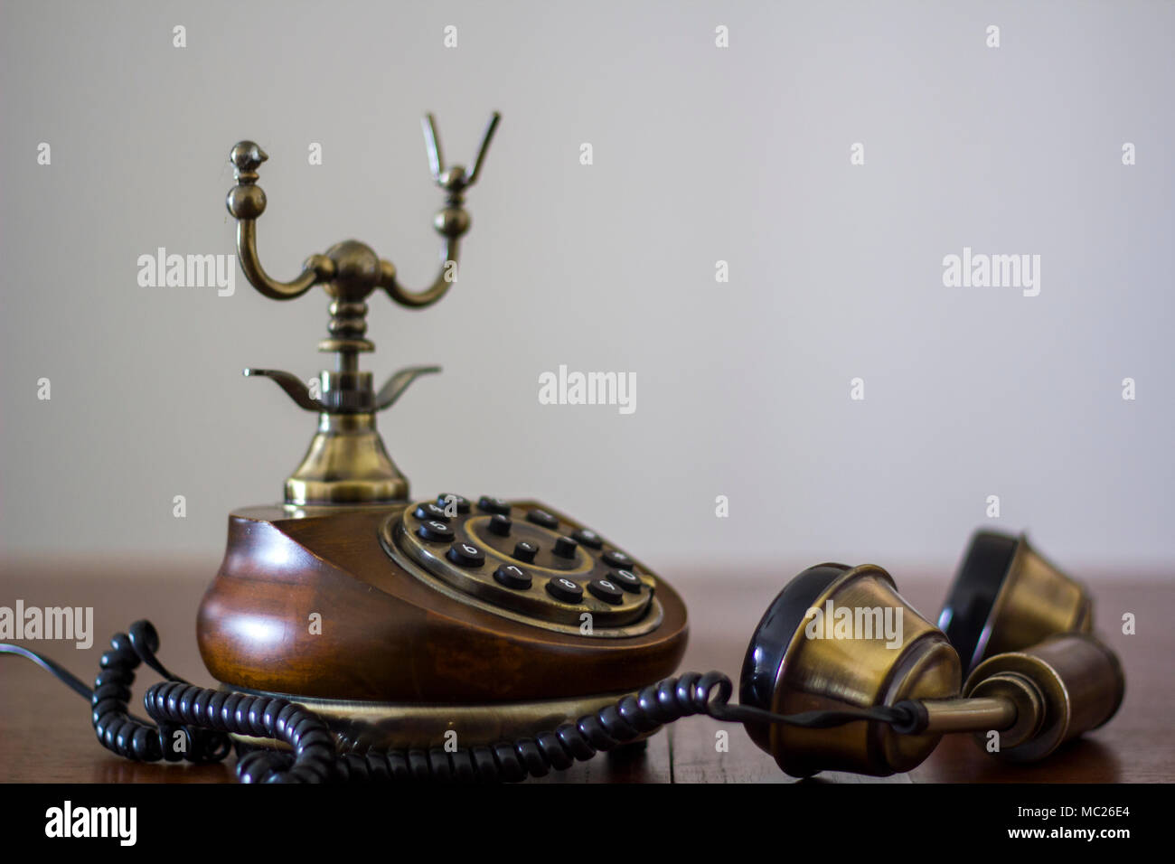 Vintage phone with handset down - Stock Image