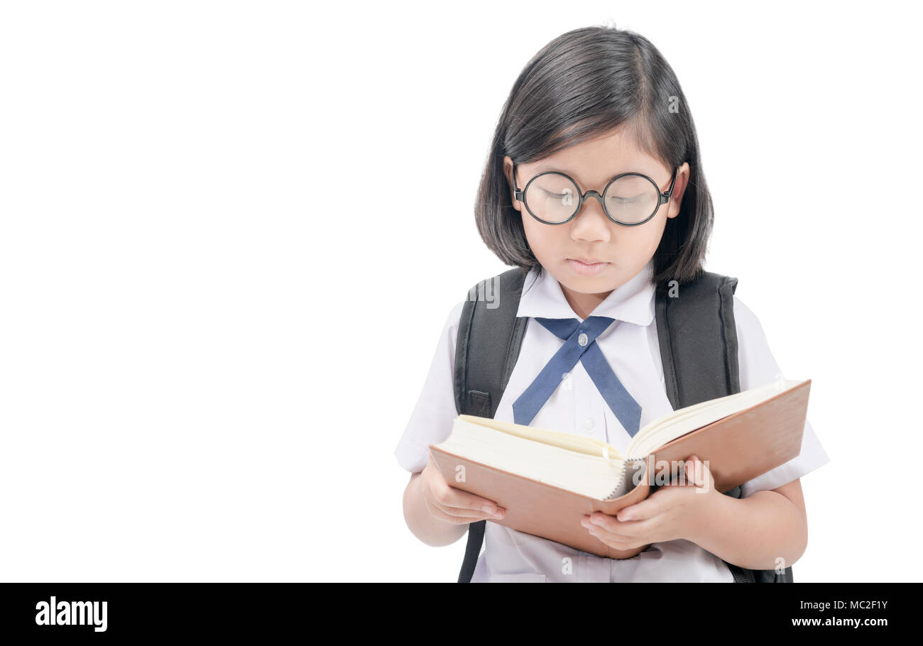 Asian Student In Uniform Wear Glasses Reading Book Isolated