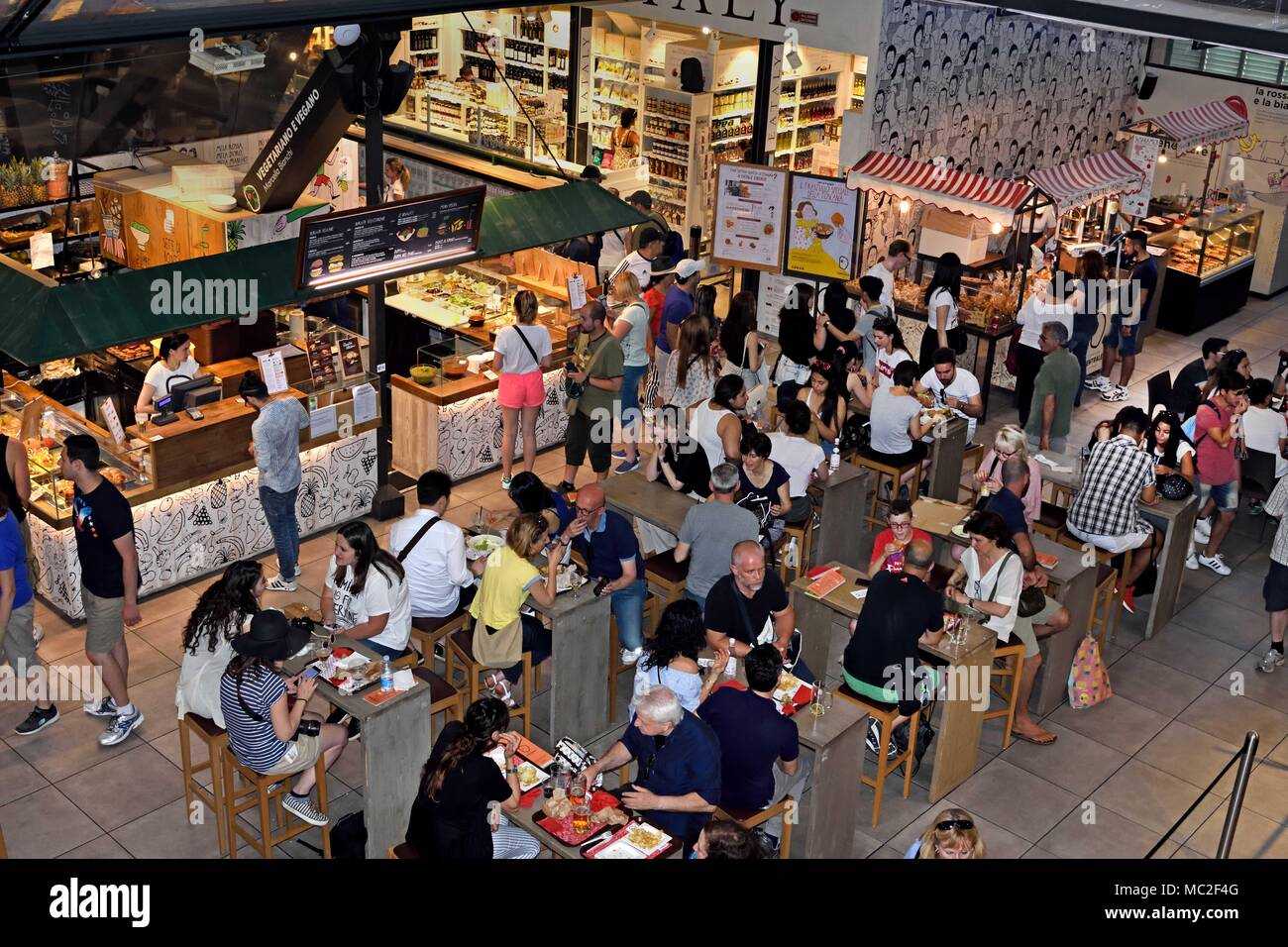 bar & crowded seating area of food court The Mercato Centrale or Mercato di San Lorenzo - Central Food Market  Florence - Tuscany, Italy - Italy Stock Photo