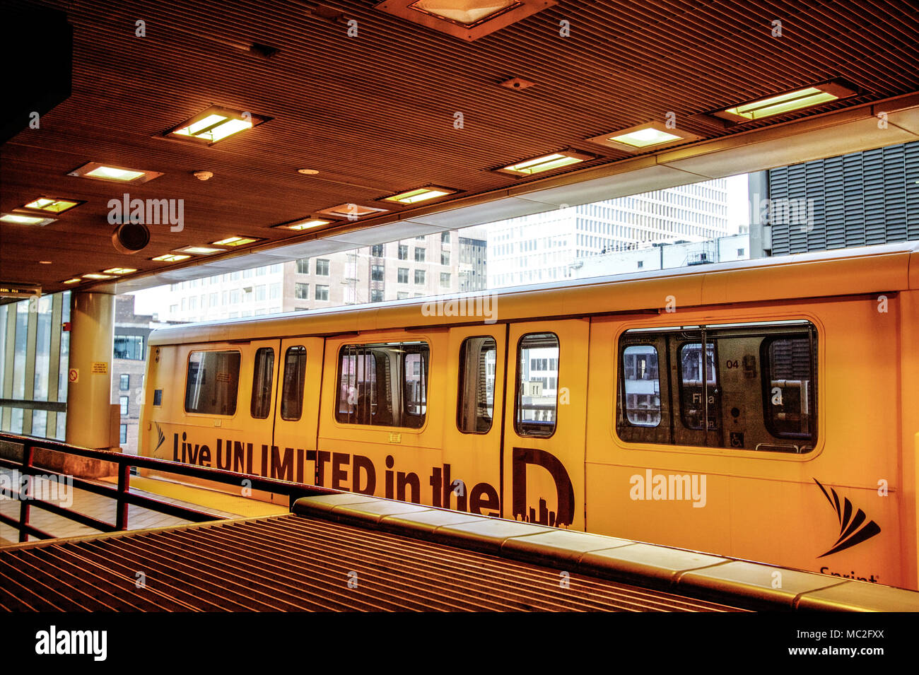 The Detroit People Mover leaves the station in downtown Detroit. The People Mover is a mass transit rail system that loops through the city with sever - Stock Image