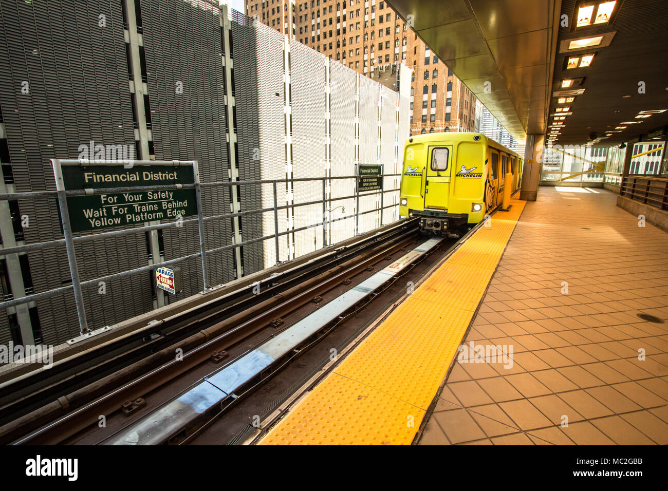The Detroit People Mover leaves the station in downtown Detroit. The People Mover is a mass transit rail system that serves the downtown area. - Stock Image