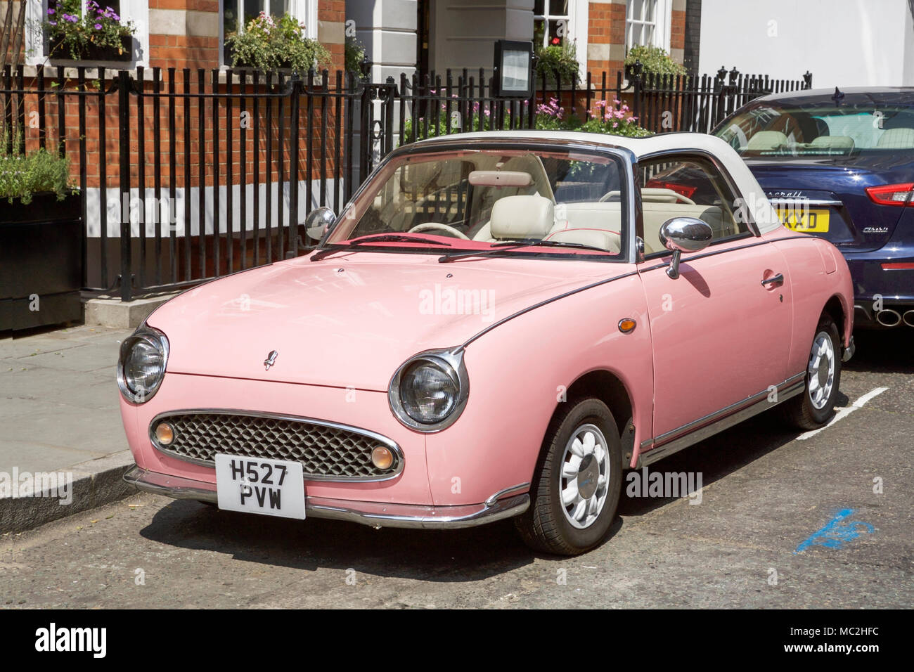 A pink Nissan Figaro car. Stock Photo