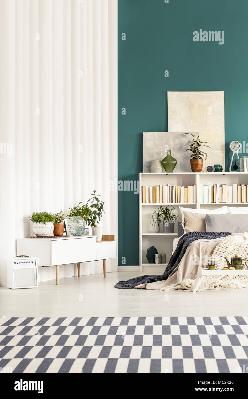 Patterned carpet in white and green bedroom interior with ...