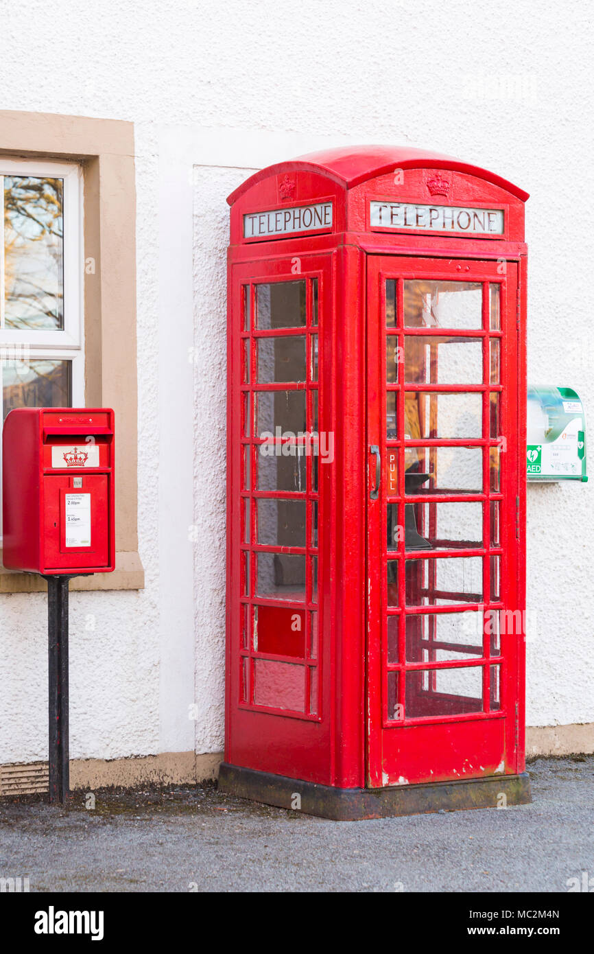 Red telephone box and red Royal Mail post box postbox outside Sligachan Hotel, Sligachan, Isle of Skye, Scotland, UK in March - Stock Image