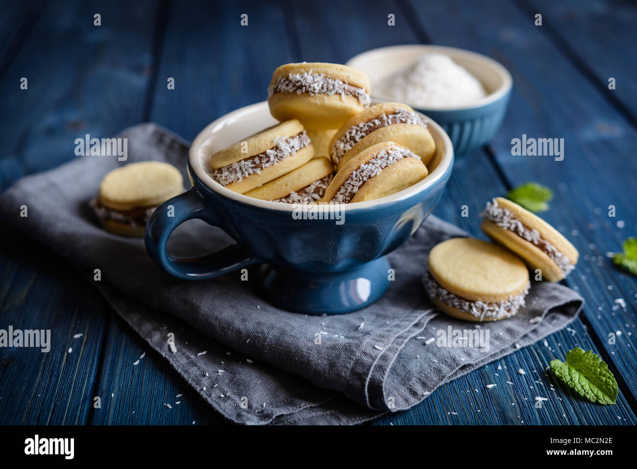 Alfajores - traditional sandwich cookies filled with caramelized milk and coconut - Stock Image
