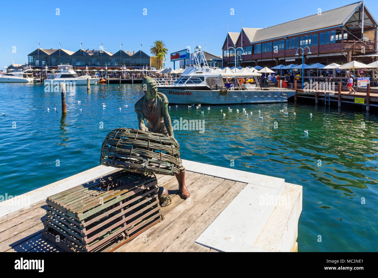 Fremantle Fishing Boat Harbour jetty and Fishermen memorial with views over to Cicerello's and Kalis Bros restaurants, Fremantle, Western Australia - Stock Image