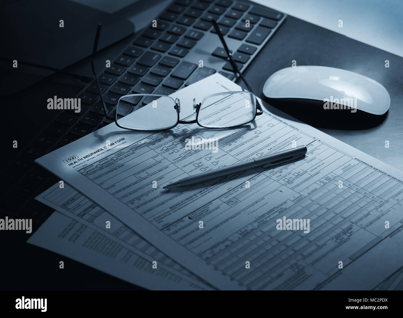 Getting ready to file a health insurance claim form - Stock Image