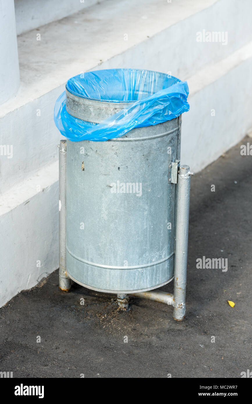 street metal trash with a package Stock Photo