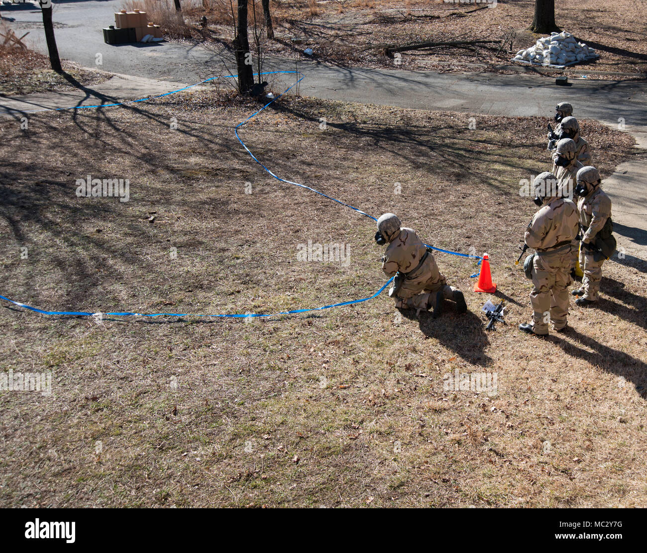 11th Wing Airmen cordon an unexploded ordnance during the Ability to Survive and Operate exercise on Joint Base Andrews, Md., Jan. 25, 2018. Cordoning UXOs sets a protective perimeter for other Airmen. (U.S. Air Force photo by Airman Michael S. Murphy) - Stock Image