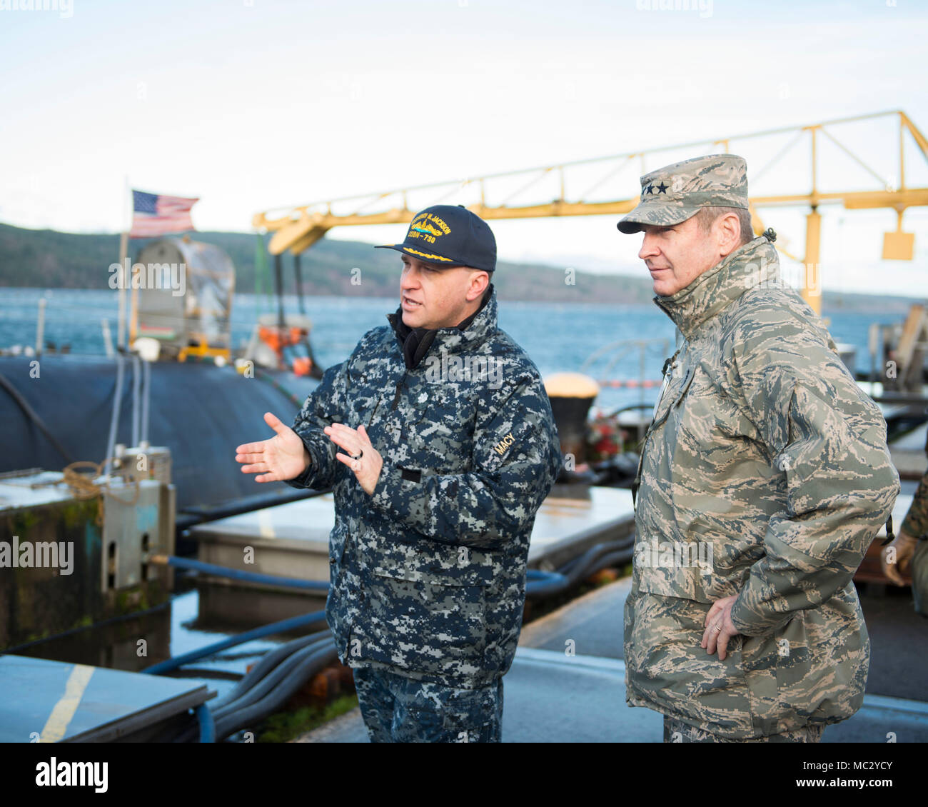 BANGOR, Wash. (Jan. 27, 2018) - Cmdr. Kevin Macy, commanding officer USS Henry M. Jackson (SSBN 730) gives a tour to Gen. Robin Rand, Air Force Global Strike Command commander.  Rand visited staff and facilities assigned to Commander Submarine Group 9 at Naval Base Kitsap-Bangor to see the operations of one leg of the nuclear triad. (U.S. Navy photo by Lt. Cmdr. Michael L. Smith/Released) - Stock Image