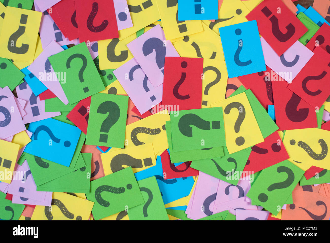 colorful paper with question mark as background. mystery,diversity,questions concept - Stock Image