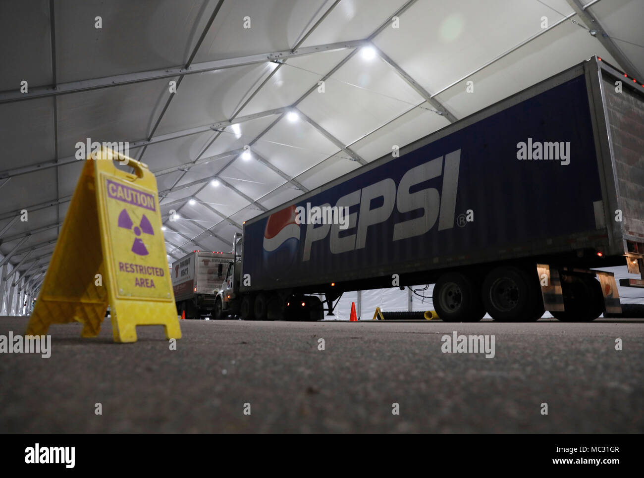 U.S. Customs and Border Protection, Office of Field Operations, officers conduct non-intrusive inspections on commercial vehicles destined for U.S. Bank Stadium to deliver provisions and equipment for Super Bowl LII in Minneapolis, Minn., Jan. 30, 2018. On Sunday, Feb. 4, the Philadelphia Eagles will face off against the New England Patriots for the NFL championship title. U.S. Customs and Border Protection photo by Glenn Fawcett - Stock Image
