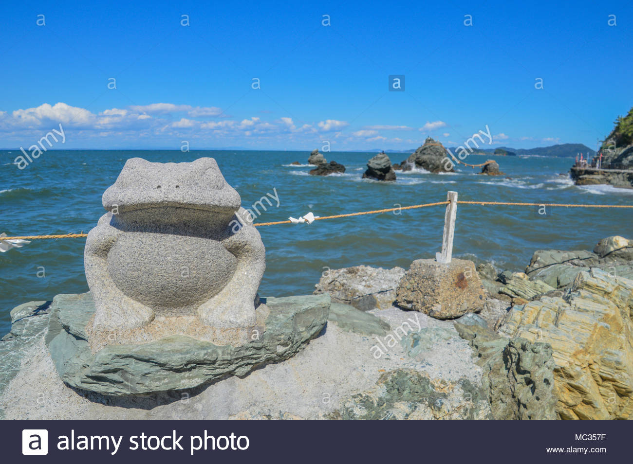 Frog Statue In Front Of Meoto Iwa (Wedded Rocks) Japan - Stock Image