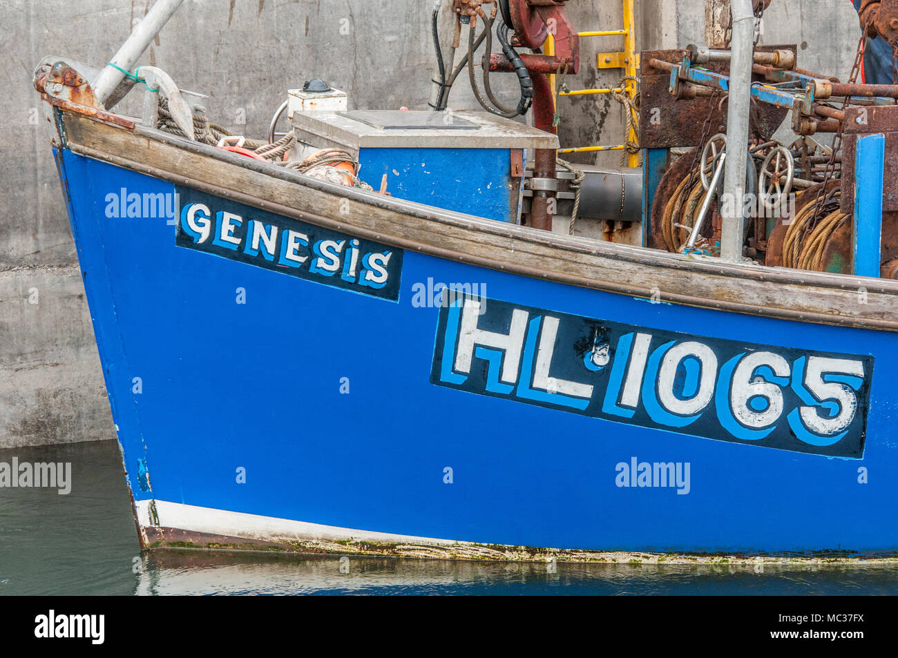 Genesis, the prow of a fishing boat moored up at Seahouses harbour, Northumberland coast. - Stock Image