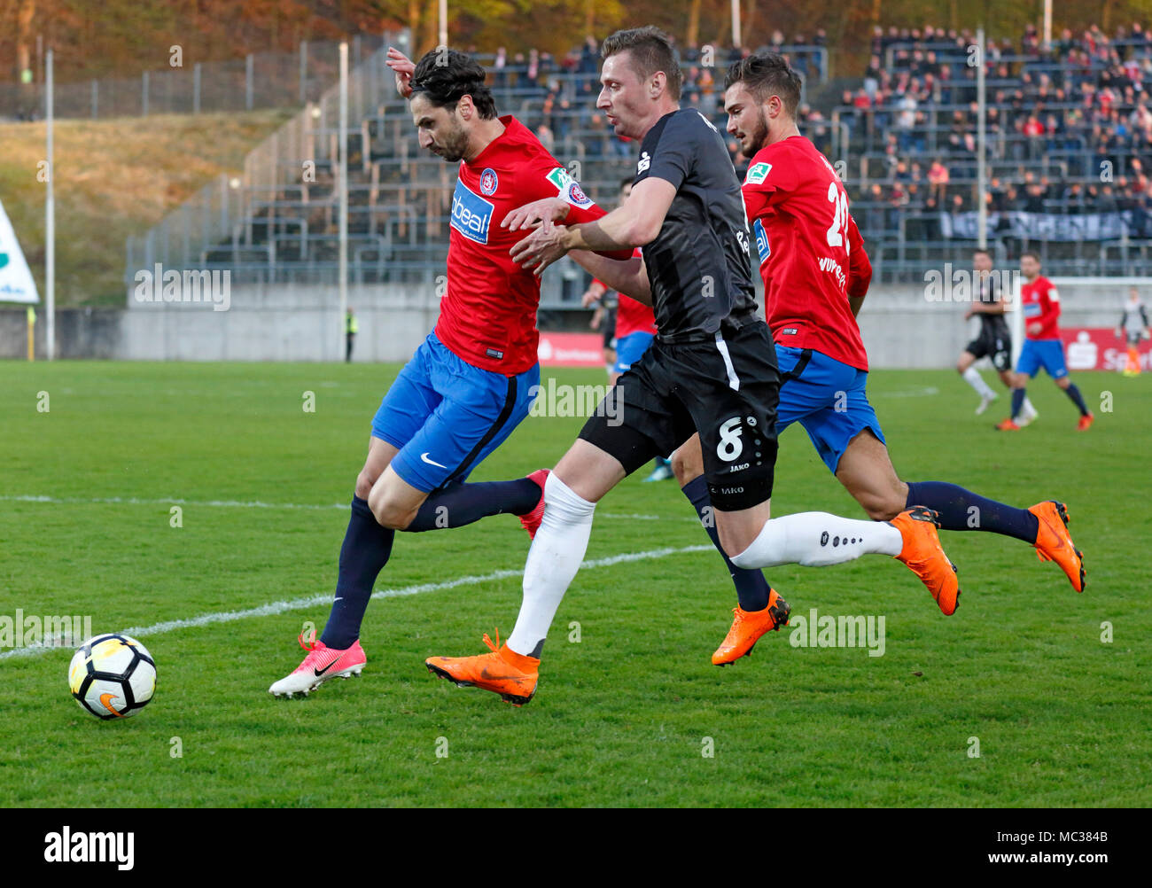sports, football, Regional League West, 2017/2018, Wuppertaler SV vs Rot Weiss Essen 3:1, scene of the match, f.l.t.r. Silvio Pagano (WSV), Kamil Bednarski (RWE), Enes Topal (WSV) - Stock Image