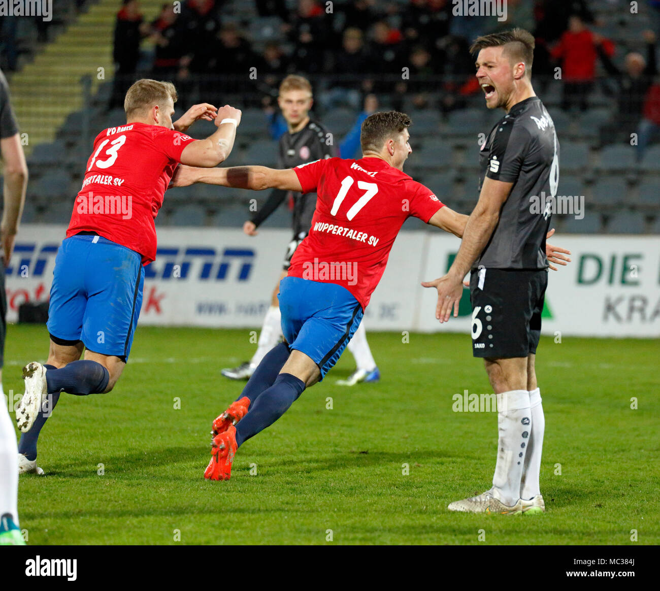 sports, football, Regional League West, 2017/2018, Wuppertaler SV vs Rot Weiss Essen 3:1, rejoicing at the 2:1 goal to Wuppertal, f.l.t.r. Christopher Kramer (WSV), triple goal scorer Enzo Wirtz (WSV), Timo Brauer (RWE) - Stock Image