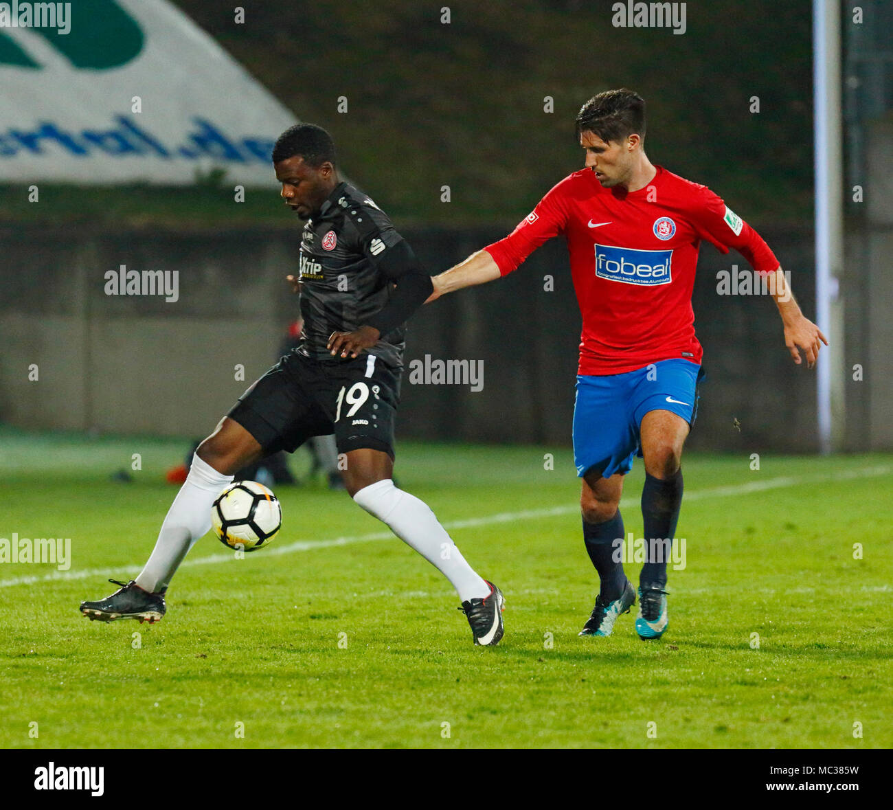 sports, football, Regional League West, 2017/2018, Wuppertaler SV vs Rot Weiss Essen 3:1, scene of the match, Hontcheu Ngankam (RWE) left and Gino Windmueller (WSV) - Stock Image