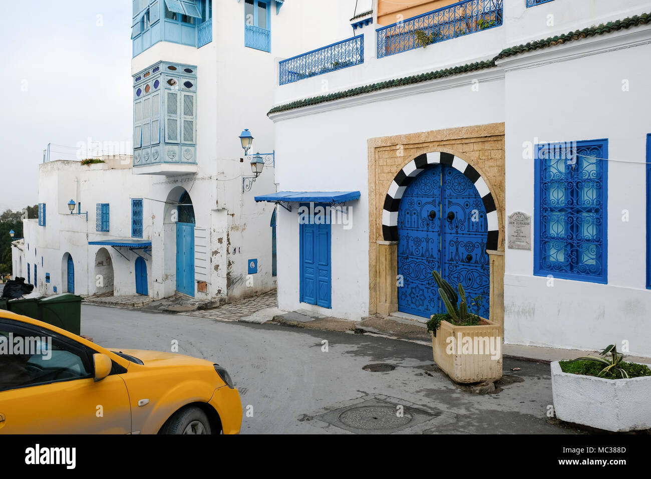 A taxi in Sidi Bou Said, in Tunesia. The city is painted in white and blue for the most part Stock Photo