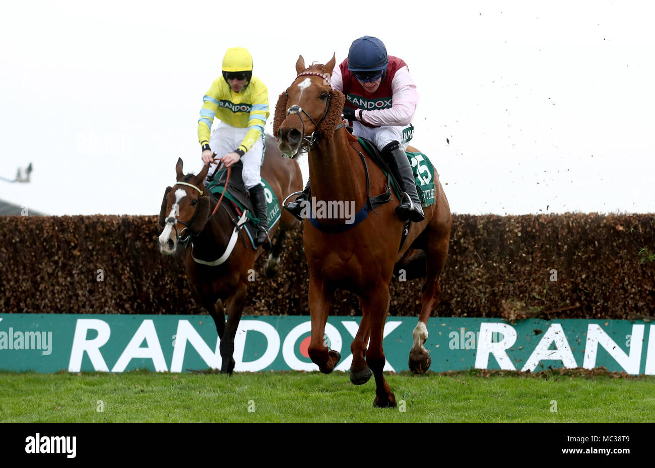 Bentelimar ridden by Jonathan Burke (front) on their way to win the Zut Media Red Red Handicap Chase during day one of the 2018 Randox Health Grand National Festival at Aintree Racecourse, Liverpool. - Stock Image