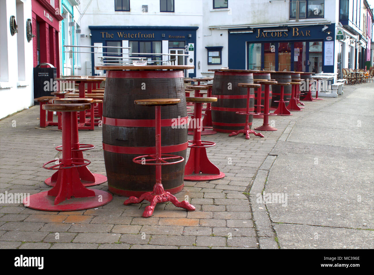 Tables And Chairs Made Up Of Barrels Set Up Waiting For